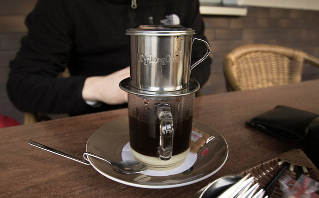 a cup of coffee with a drip in it