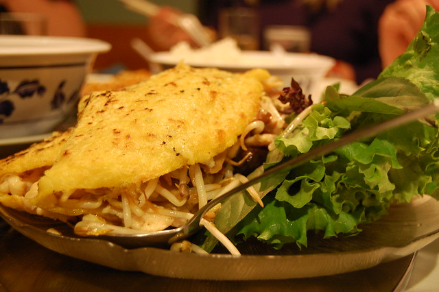 a yellow omelette type of crepe stuffed with filled