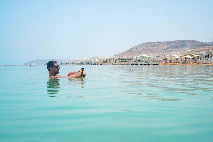 A man floating in the dead sea, israel