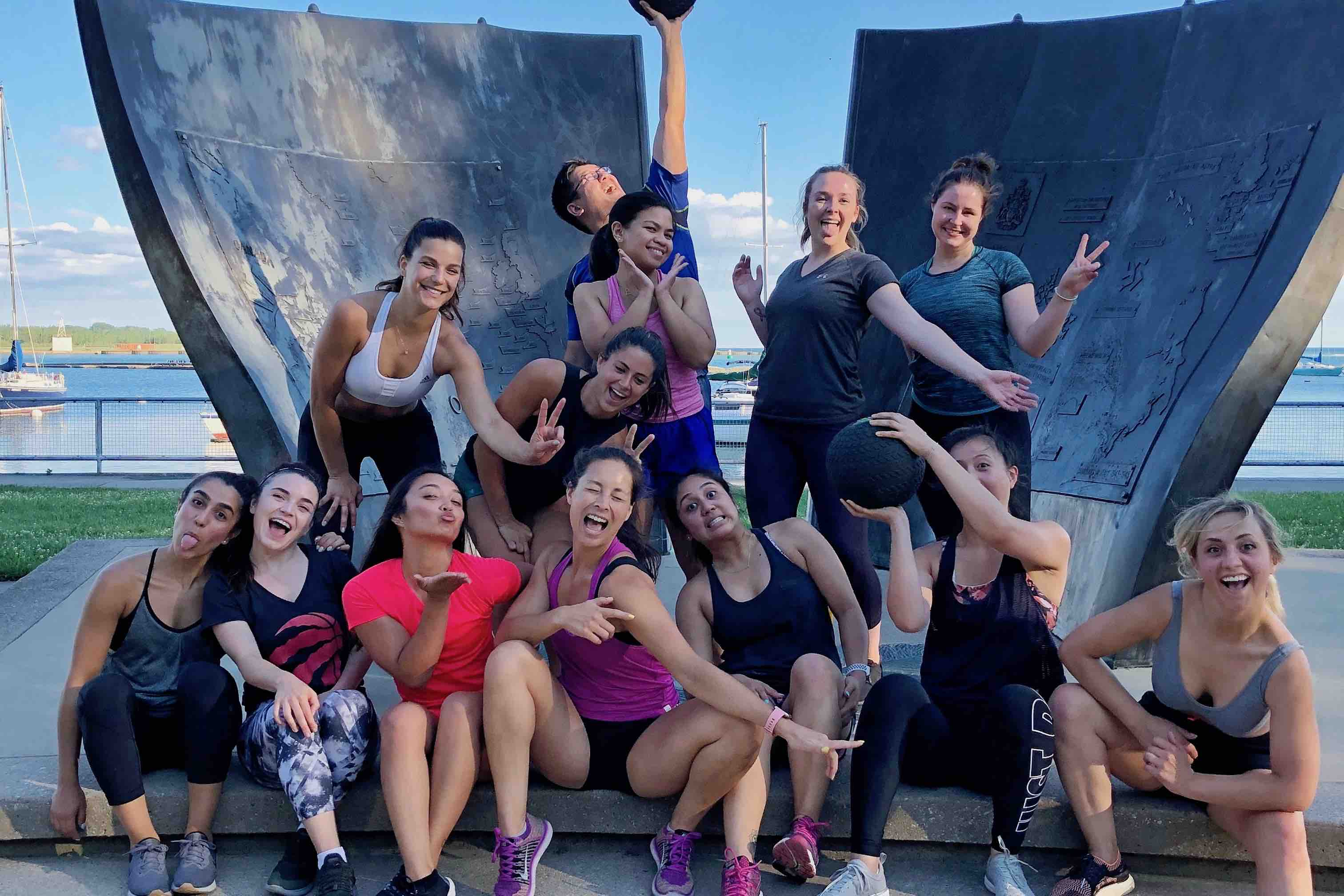 a group of people posing after a workout