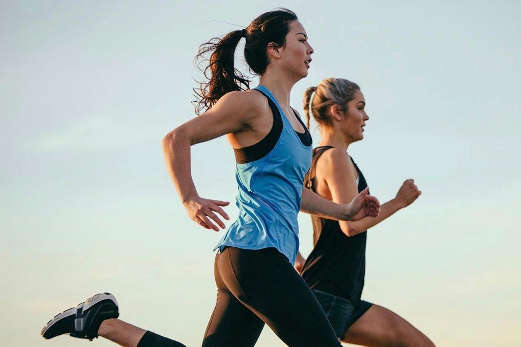 two women running side by side