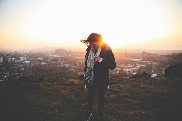 Woman on a hilltop in Edinburgh, United Kingdom