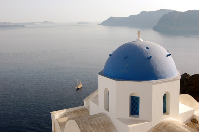 Blue domed building in Oia, Greece