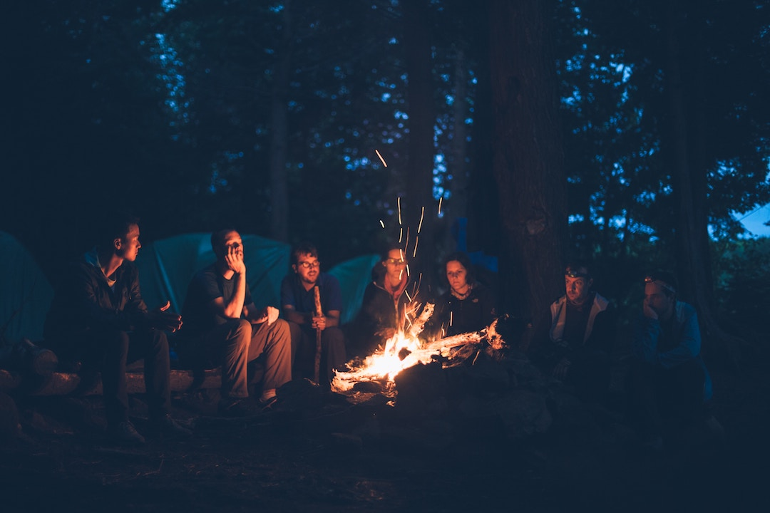A group of friends sitting around a fire