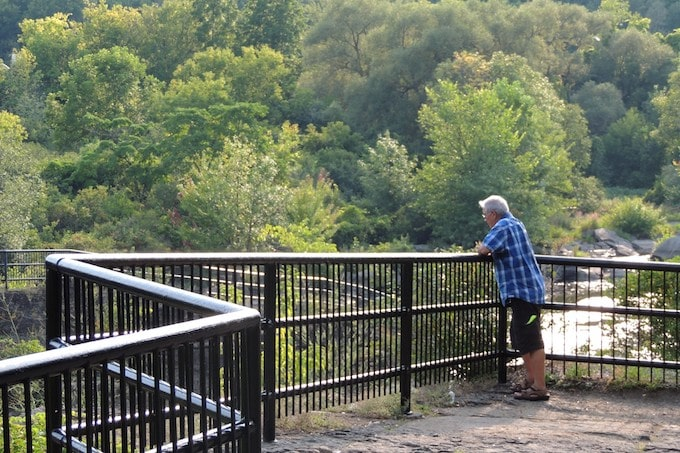 A man standing on an overlook
