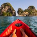 A person relaxing in a red kayak in Krabi, Thailand