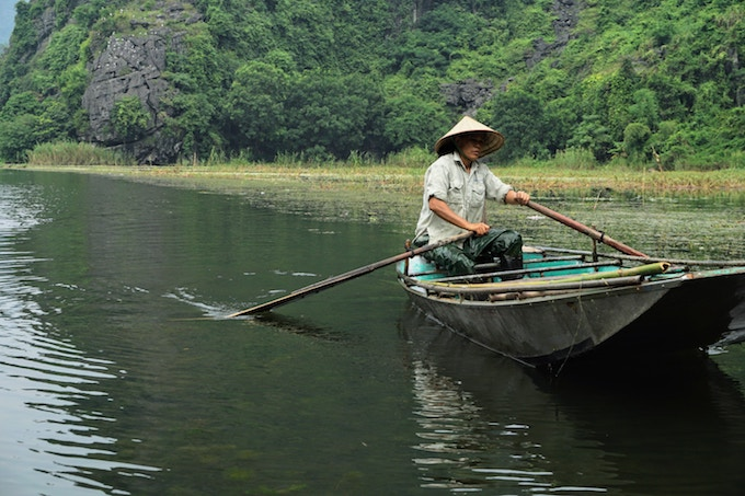A person rowing a boat in Tam Coc, Vietnam