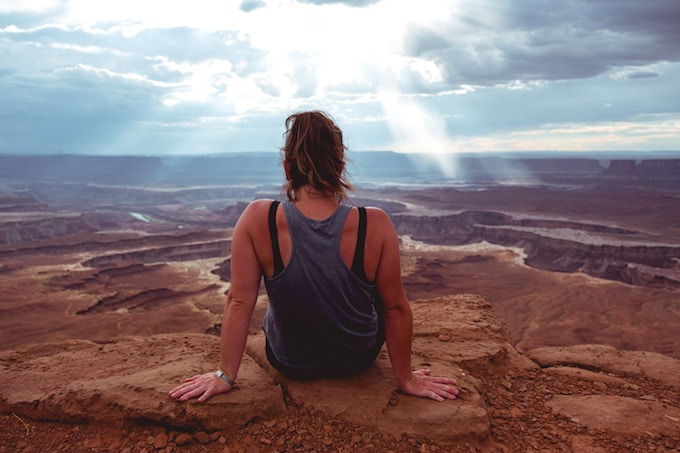 A woman sitting in canyonlands national park