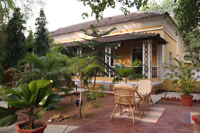 A small yellow bed and breakfast in Goa, India