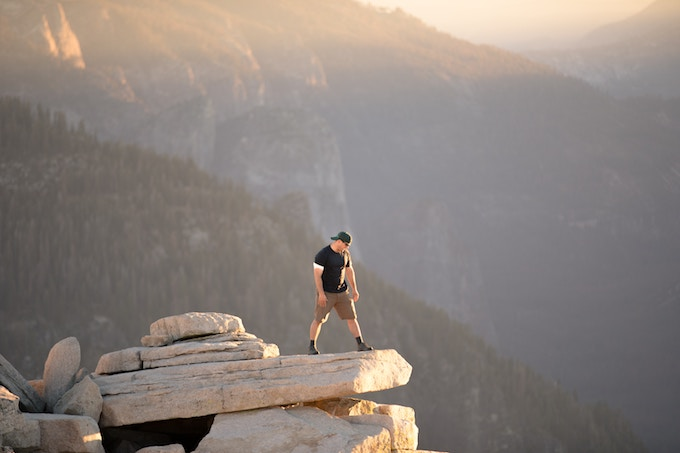 A man standing on top of Half Dome, Yosemite