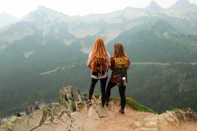 Two women standing on the summit of Mount Rainier