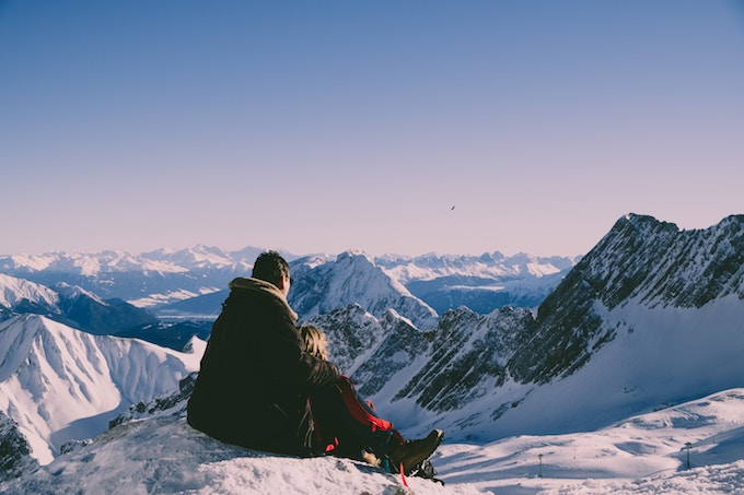 A couple on the summit of Zugspitze, Germany