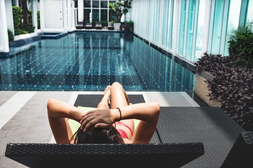Woman lounging by hotel pool