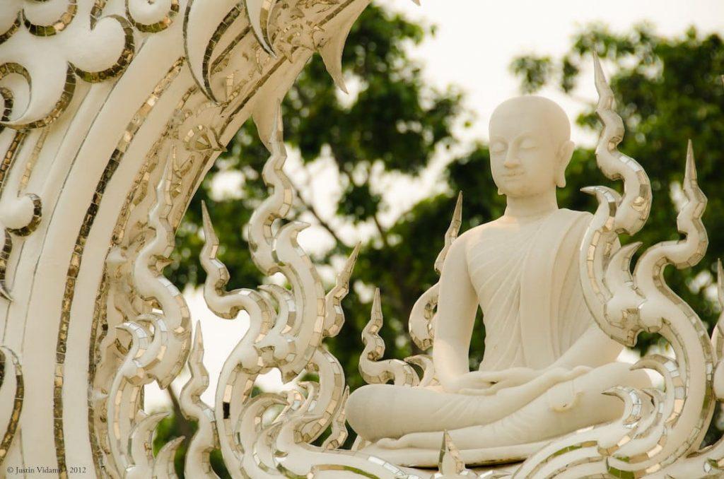 A Buddha detail on the White Temple in Chiang Rai, Thailand