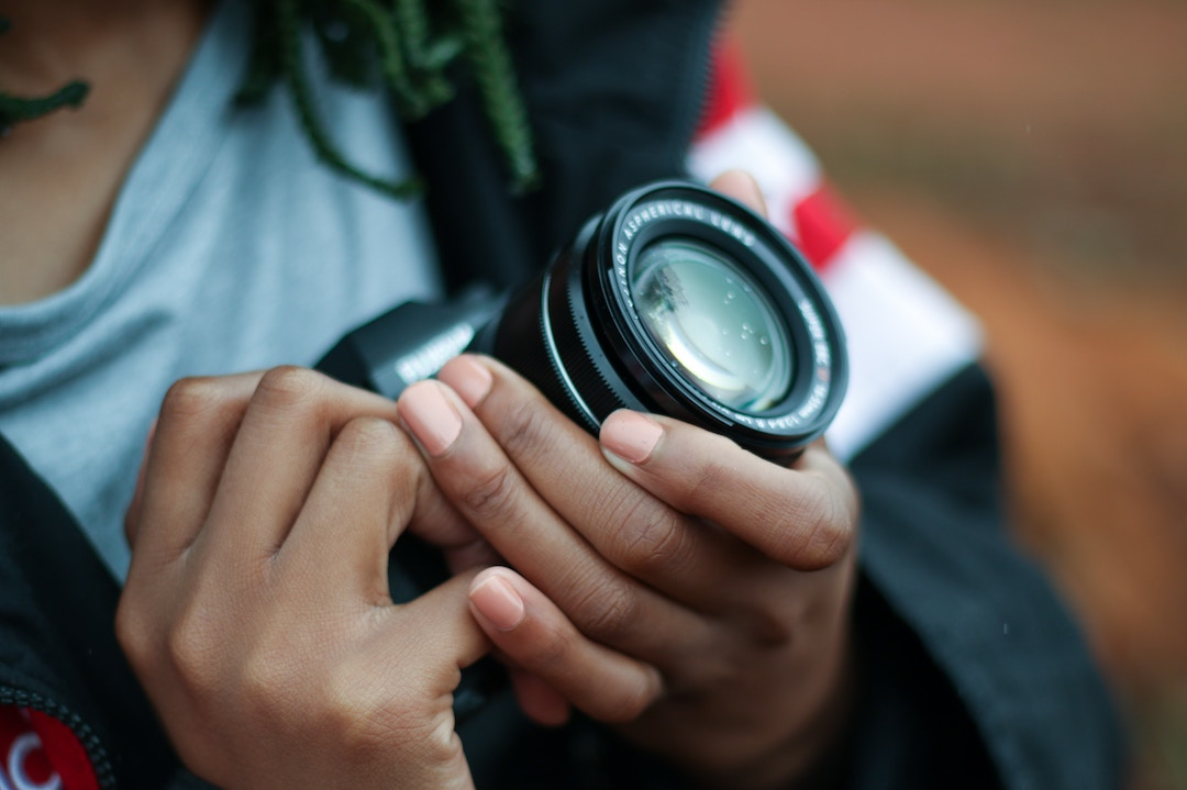 A person holding a camera up close