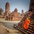 A monk walking down a temple in Ayutthaya, Thailand