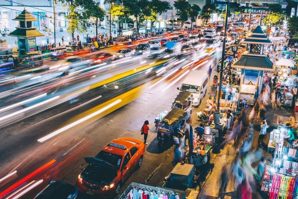 Traffic and people walking on a street in Bangkok