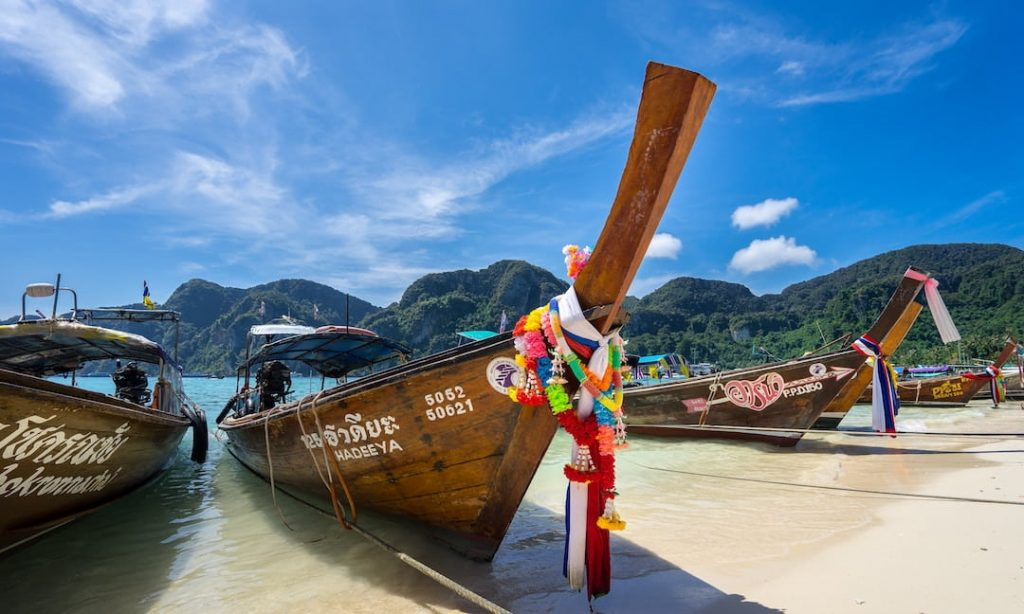 Long-tail boats on a beach in Thailand