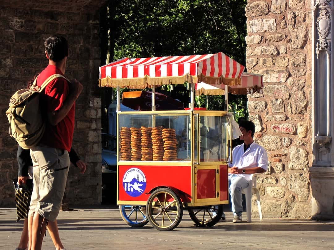Vendor selling simit from a red push-cart in Istanbul, Turkey