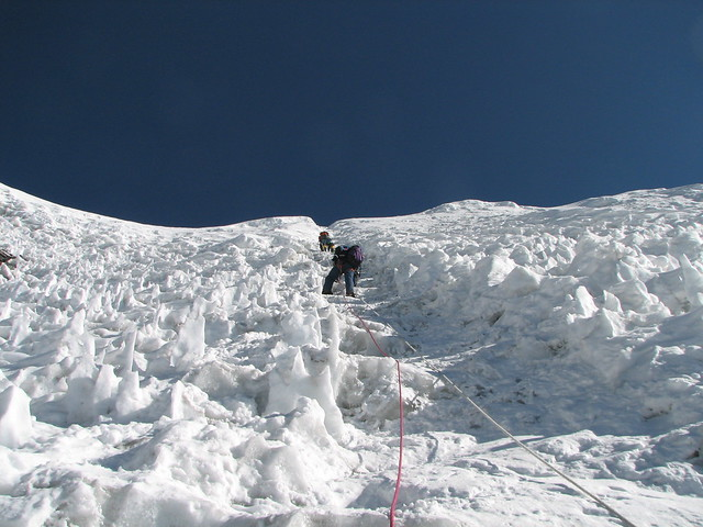 a climber uses fixed ropes through ice