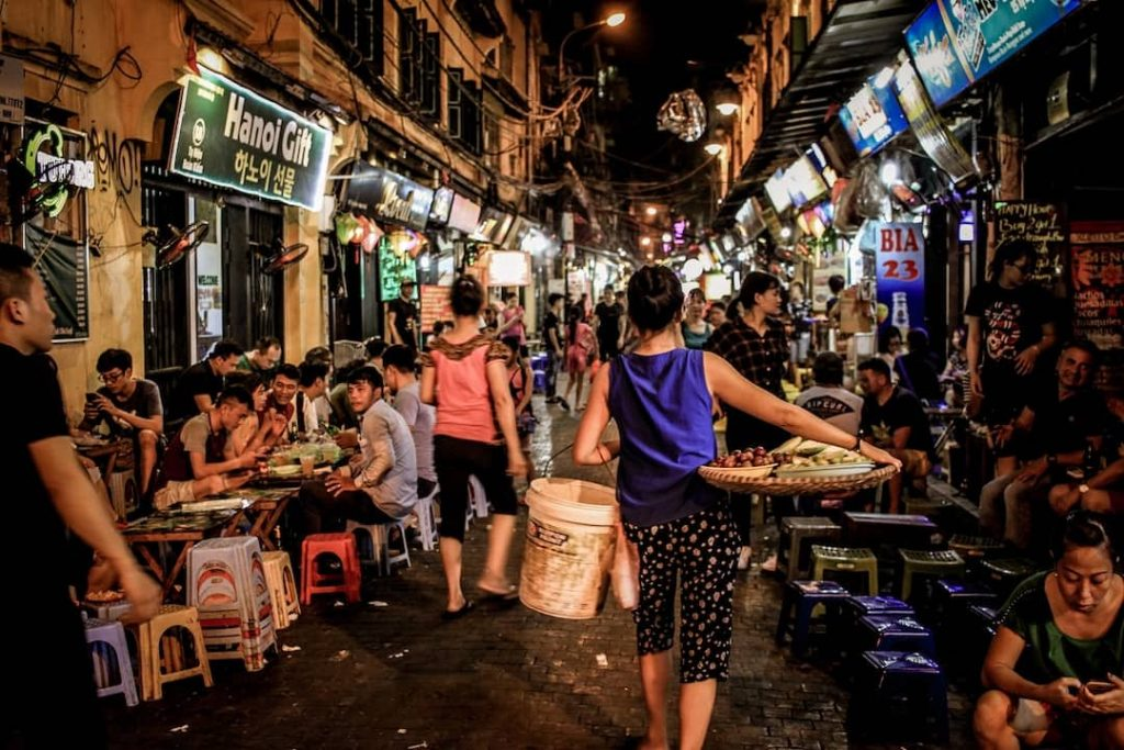 People sitting on the street eating and drinking beer in Hanoi, Vietnam
