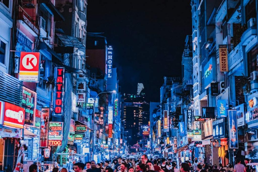 Busy street filled with people at night in Ho Chi Minh City, Vietnam