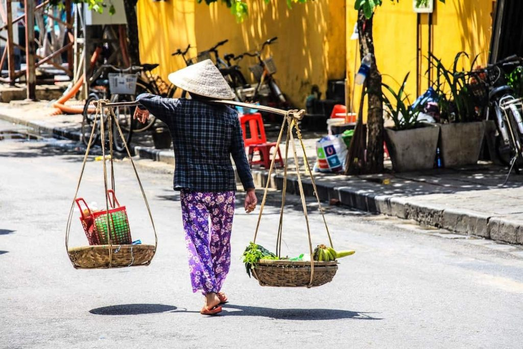 Vendor selling fruit in Hoi An's Old Town