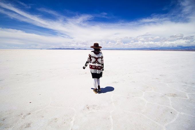 A woman standing on the Bolivian Salt Flats