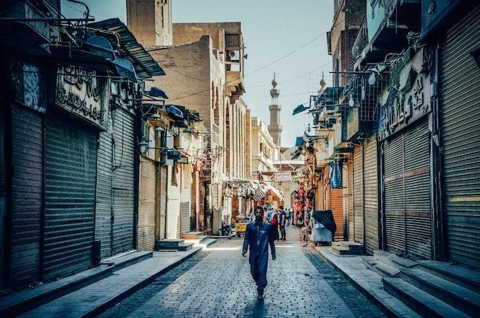 A man walking through a market in Cairo, Egypt