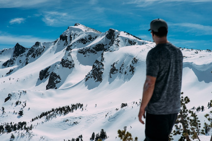 A man standing in view of Mammoth Mountain, California, USA
