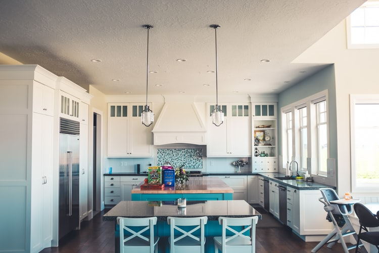 blue and white kitchen with island and table