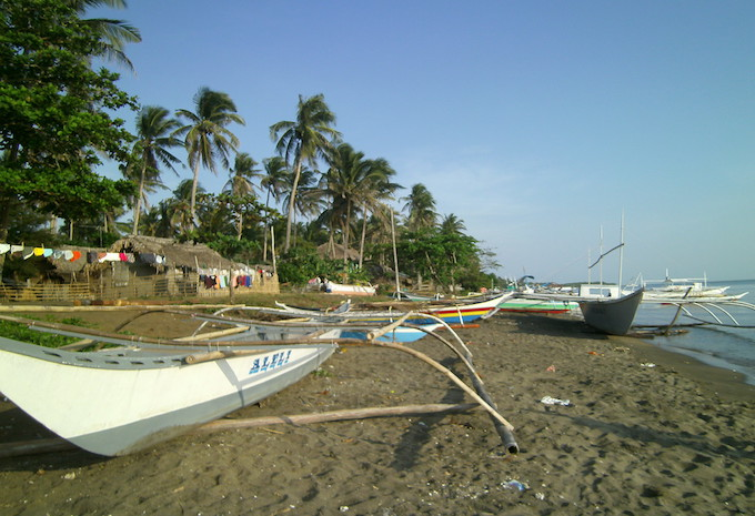 Boats on the shore in Donsol, the Philippines