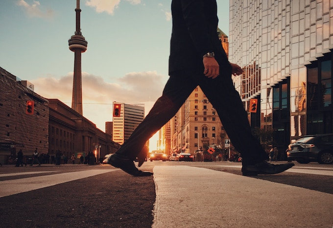 A man crossing the road in Toronto, Canada