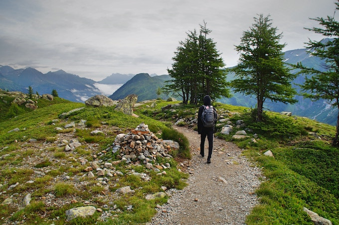 A man hiking on a trail in Lac Blanc, Chamonix, France