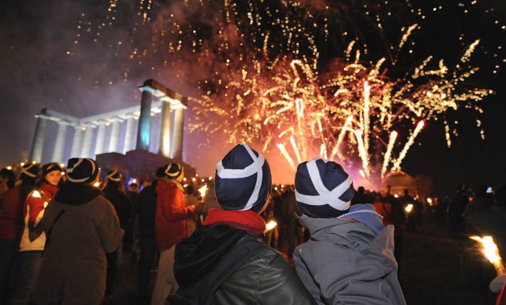 Two people watching fireworks on Hogmanay in Edinburgh, Scotland