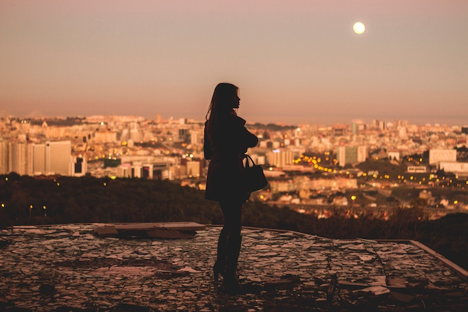A woman standing on a hill in Lisbon, Portugal