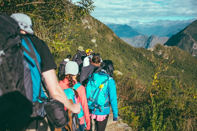 A group of people hiking in Aguas Calientes, Peru