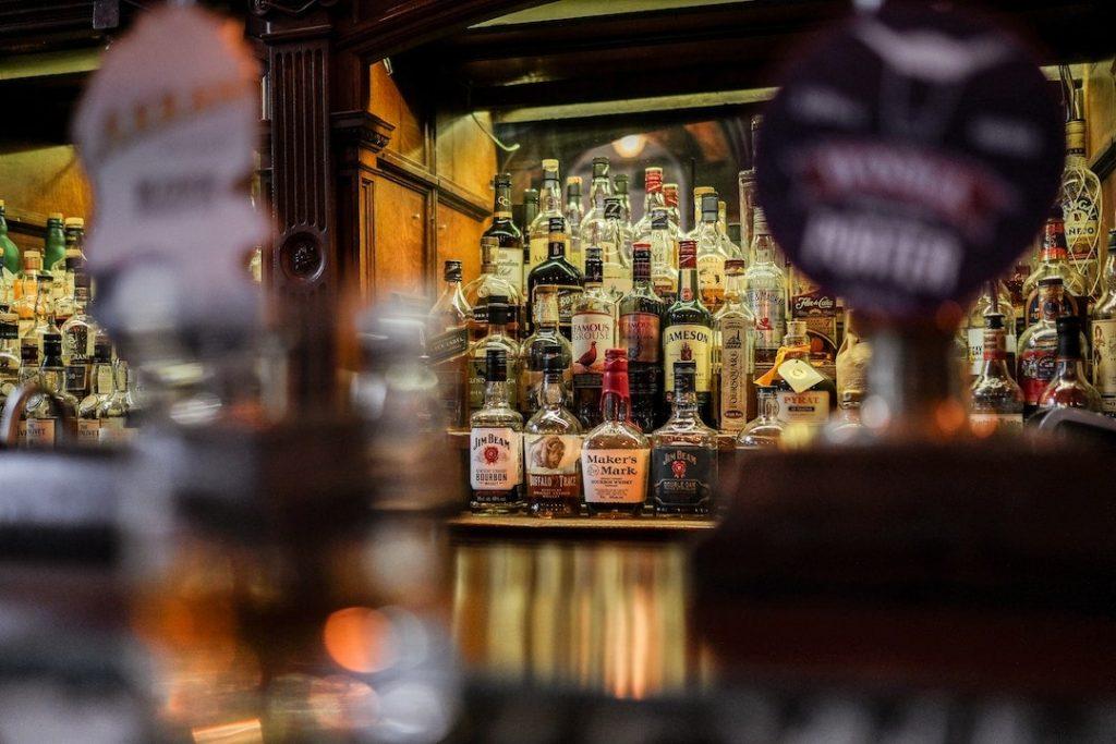 Bottles of whisky on a shelf in a pub in Edinburgh, Scotland