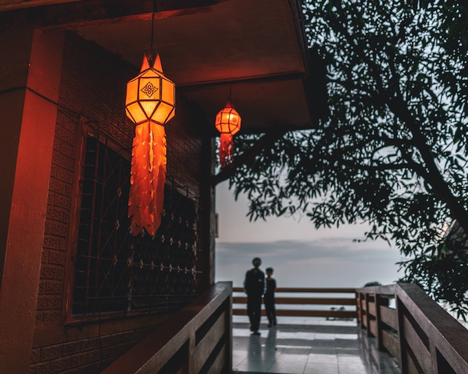 Two people standing on a balcony overlooking a valley in Chiang Mai, Thailand