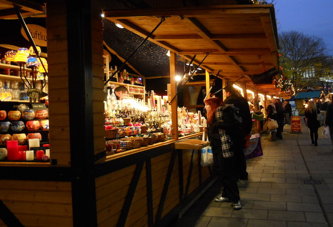 A woman standing at a Christmas market stall in Bristol