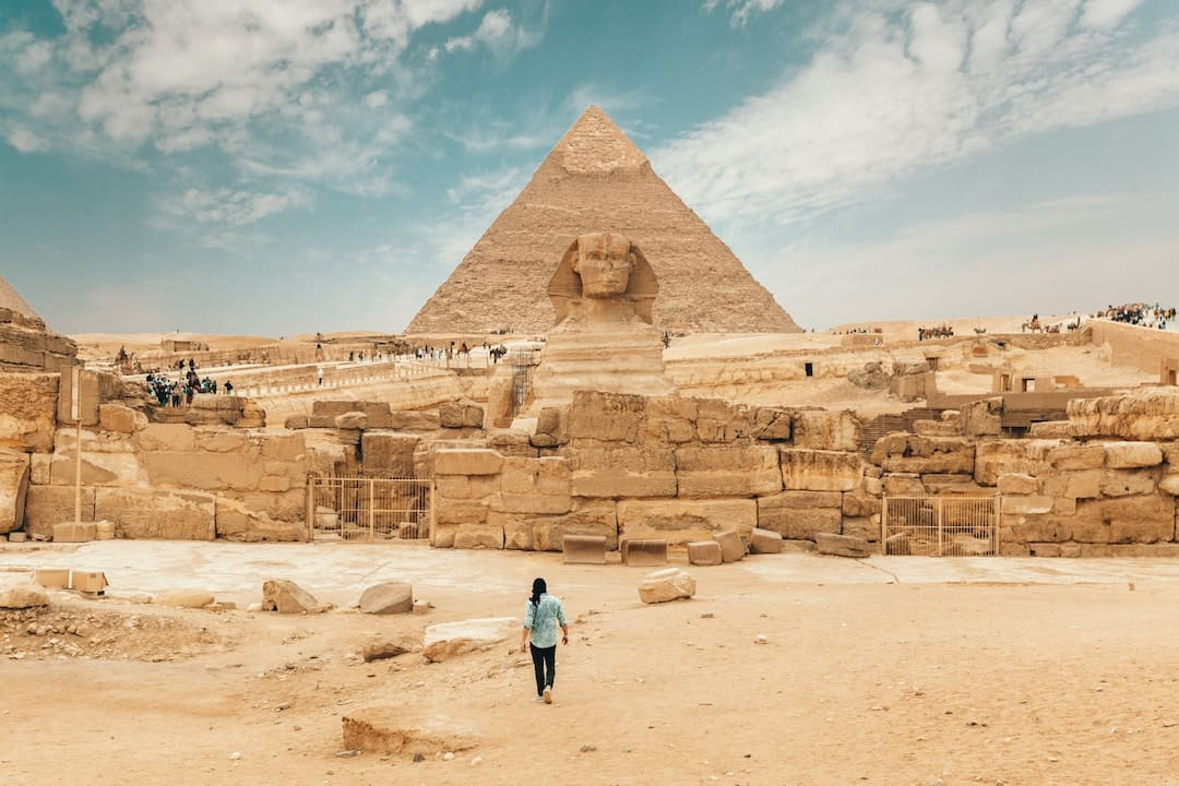 A man walking towards a Pyramid in Egypt