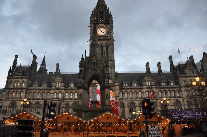 A christmas market outside Town Hall, Manchester, UK