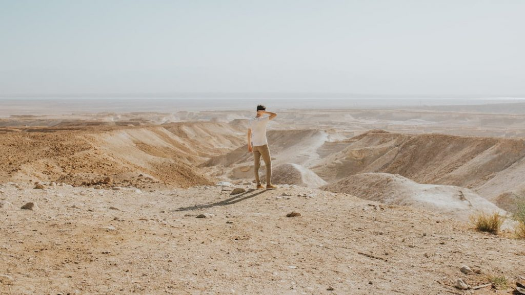 Man standing at the edge of a look-out point in Masada National Park, Israel