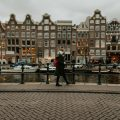 Woman walking a canal in Amsterdam