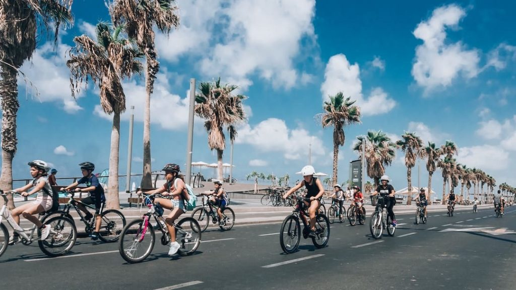 People cycling on a road in Tel Aviv