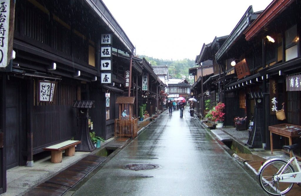 A street lined with traditional wooden buildings in Takayama, Japan