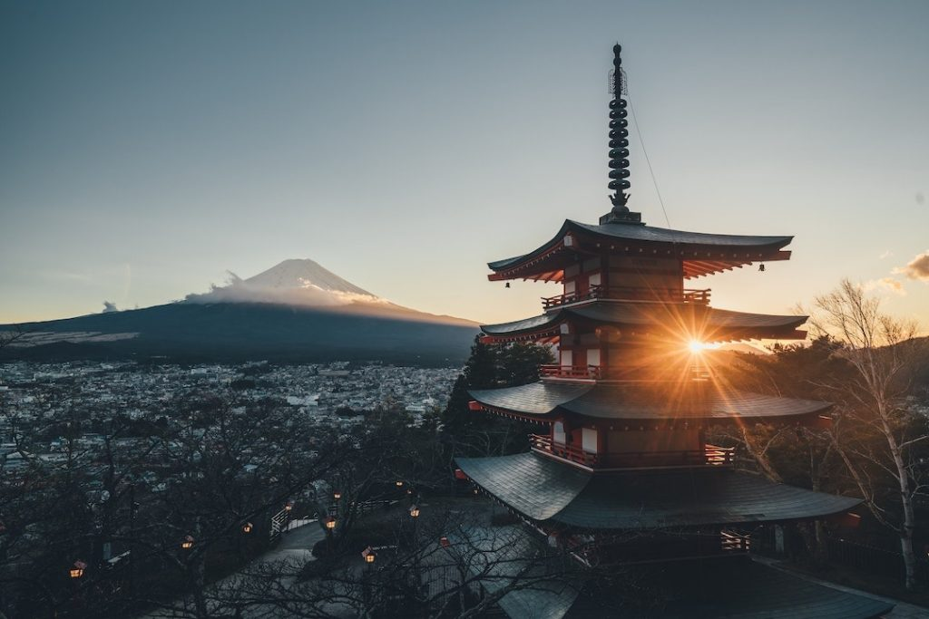 A view of Mont Fuji and a pagoda at sunset in Japan
