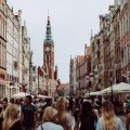 brown clock tower, a street full of busy people