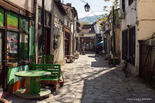 a narrow cobbled path through an alleyway