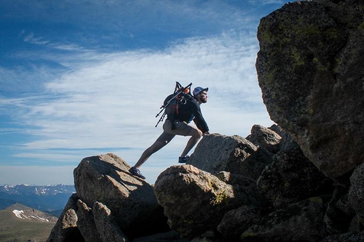 a man on rocks climbing